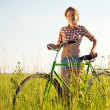 Young girl with  bicycle - Stock Photo