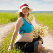 Stock Photo: Pregnant womon summer road