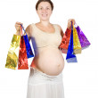 Pregnant woman with shopping bags - Stock Photo