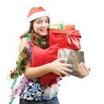 Teenage girl with Christmas gifts — Stock Photo