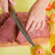 F cook hands cutting beef — Stock Photo