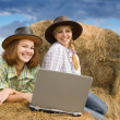 Two country girls with notebook - Stock Photo