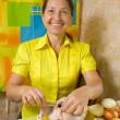 Woman sewing chicken by toothpicks — Stock Photo