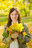 Portrait of girl with autumn bouquet — Stock Photo