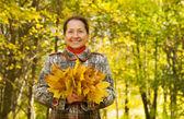 Senior woman in autumn — Stock Photo