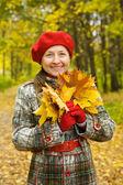 Portrait of senior woman in autumn — Stock Photo