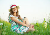 Girl in hat on meadow — Stock Photo