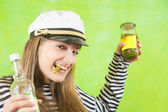 Female sailor with bottle of vodka and pickle — Stock Photo