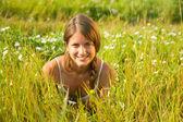Girl lying in meadow grass — Stock Photo