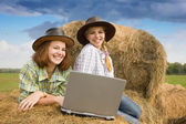 Two country girls with notebook — Stock Photo