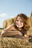 Girl enjoying on hay — Stock Photo