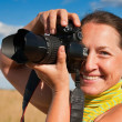 Senior woman photographer — Stock Photo