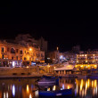 Stock Photo: Boats at St. Julian's bay in night