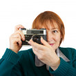 Stock Photo: Woman taking photo with vintage camer