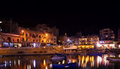 Boats at St. Julian's bay in night — Stock Photo