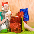 Stock Photo: Teenager girl with Christmas gifts