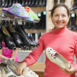 Stock Photo: Womchooses shoes at shoes shop