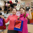 Women with shopping bags in underwear shop — Stock Photo #4612682
