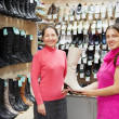 Royalty-Free Stock Photo: Women chooses high boots