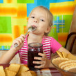 Stock Photo: Little girl eating confiture