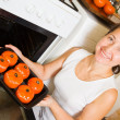 Woman roasting farci tomato — Stock Photo #4614117