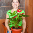 Mature woman with anthurium — Stock Photo #4614887
