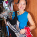 Woman chooses dress in wardrobe — Stock Photo #4615040