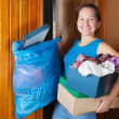 Woman taking away the garbage - Stock Photo