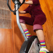 Woman on bicycle simulator - Stock Photo