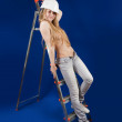 Topless girl in hard hat on stepladder — Stock Photo