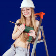 Sexy girl in hard hat with drill — Stock Photo