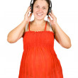 Stock Photo: Regnant womlistening to music