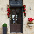 Door with Christmas decorations — Stock Photo