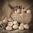 Retro photo onion in basket — Stock Photo