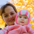 Mother with  baby  in autumn — Stock Photo