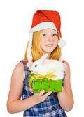 Girl in santa hat with pet rabbits — Stock Photo