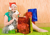Teenager girl with Christmas gifts — Stock Photo