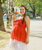 Pregnant woman with ice-cream — Stock Photo
