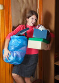 Woman taking away the garbage — Stock Photo