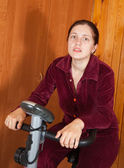 Woman working out on spinning bike — Стоковое фото