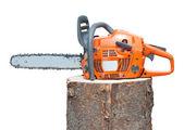 Chain saw on log — Stock Photo