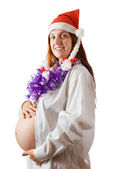 Pregnant woman with in santa hat — ストック写真