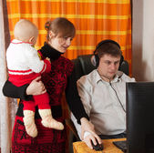 Family with computer at home — Stock Photo