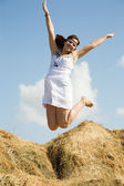 Jumping country girl — Stock Photo