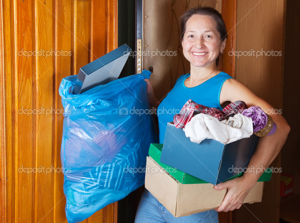 Mature woman taking away the garbage at home — Stock Photo #4615094