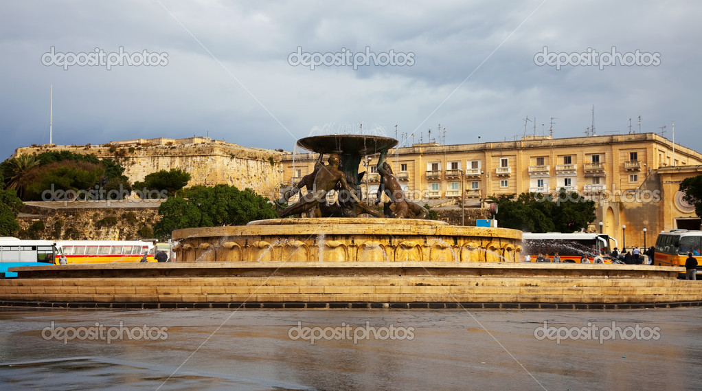 Triton fountain with sculpture at Valletta bus terminal and main gate. Malta — Stock Photo #4618794