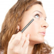 The girl puts mascara on with pen — Stock Photo
