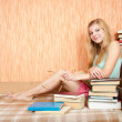 Stock Photo: Smiling womwith books