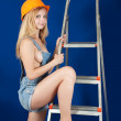 Stock Photo: Sexy girl in hardhat with stepladder