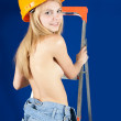Topless girl in hardhat — Stock Photo